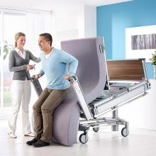 Медицинские кровати с вертикализатором